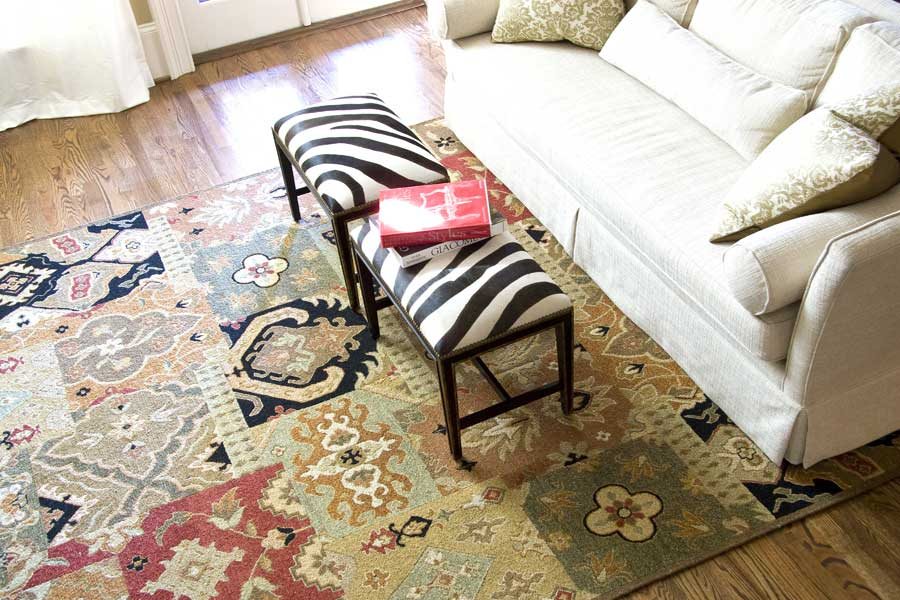 custom size rug with a tribal design in a living room