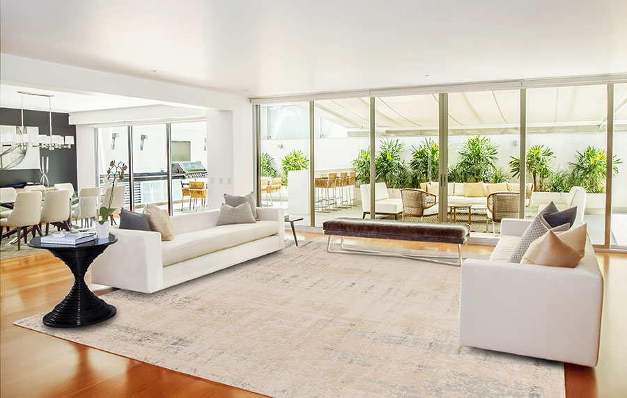 cream colored transitional rug in an open plan room