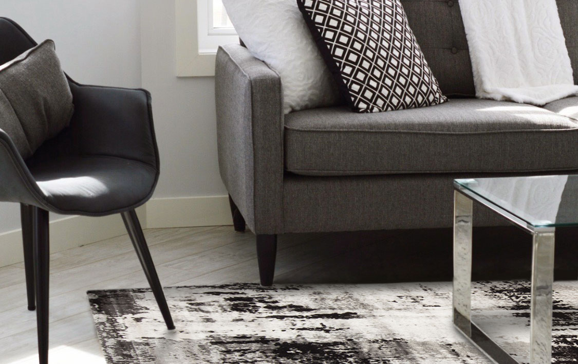black and white rug in a monochrome-inspired space