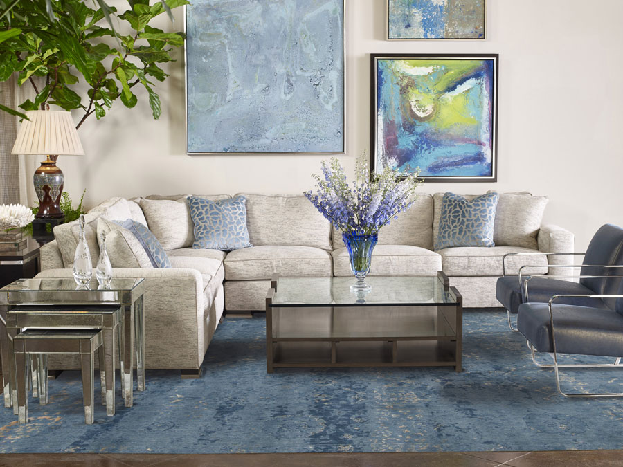 a blue area rug placed in the living room