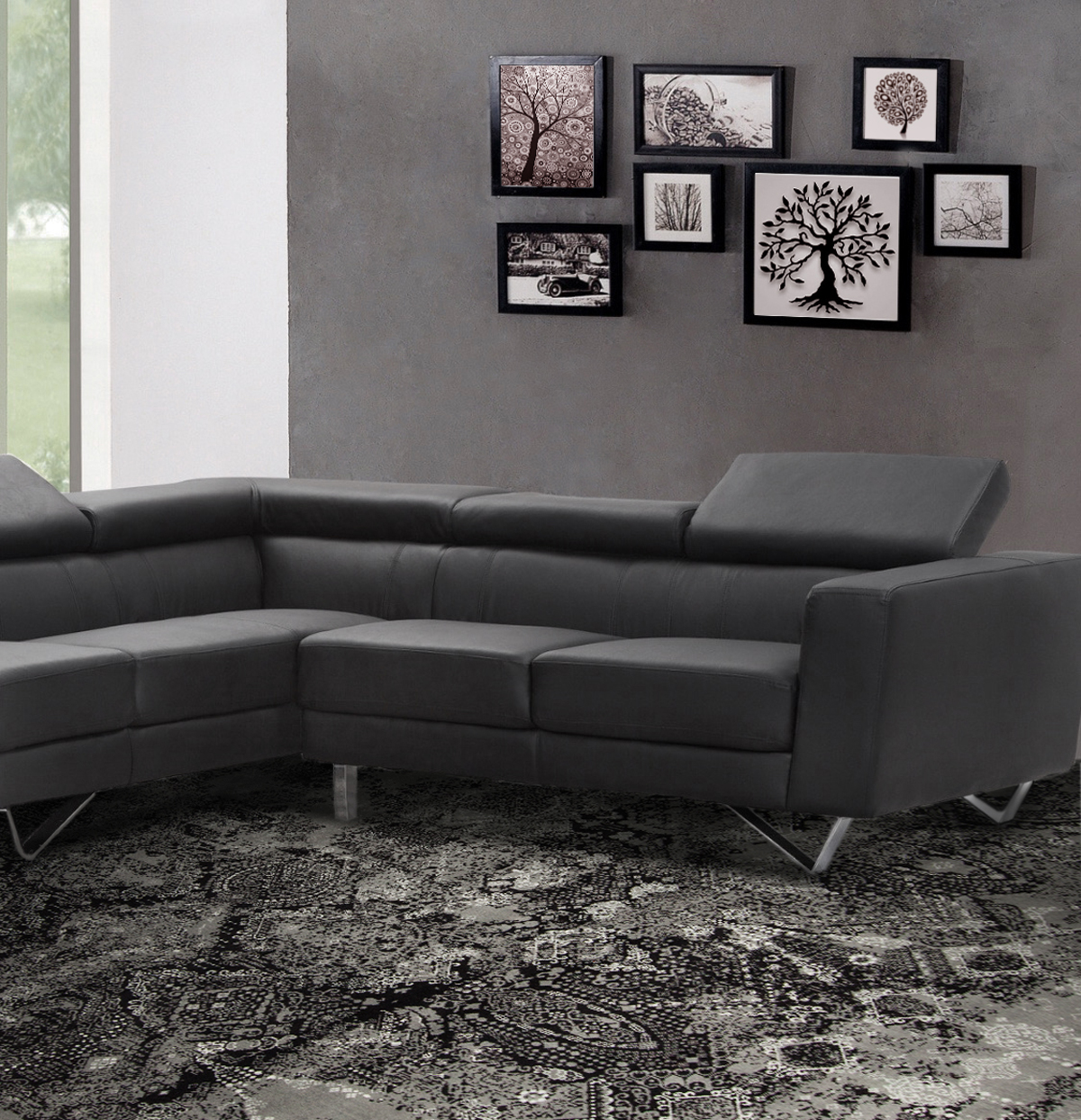 living room with gray sofa and black and white rug