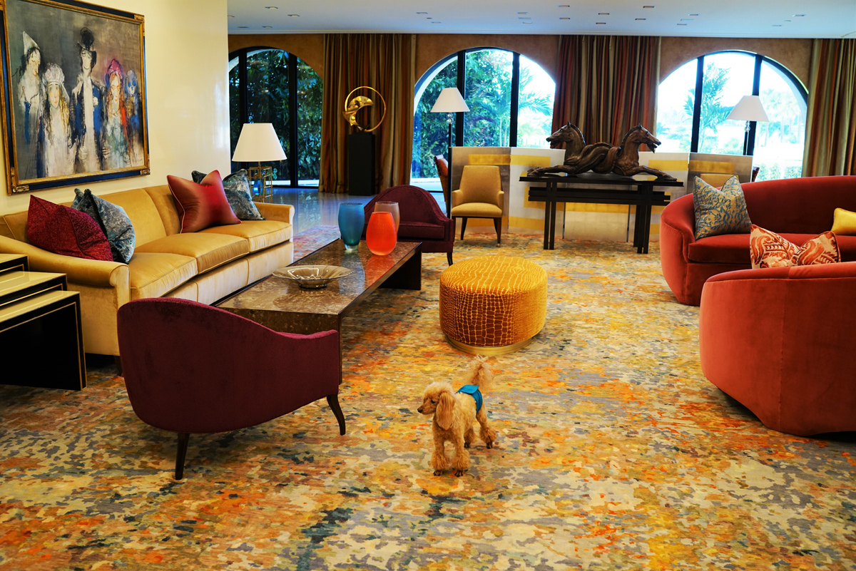 living room with a large yellow and gray area rug