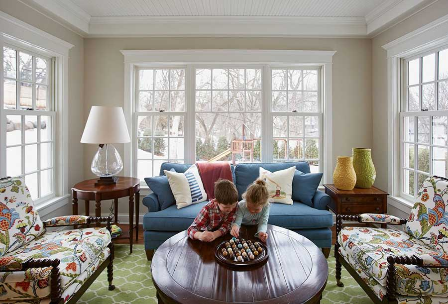 two kids side-by-side in a cape cod-inspired room
