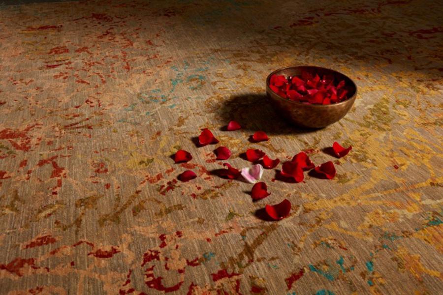 artisan rug and rose petals
