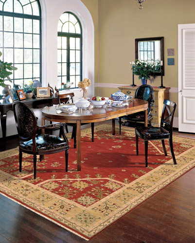 red and yellow tribal rug in the dining room