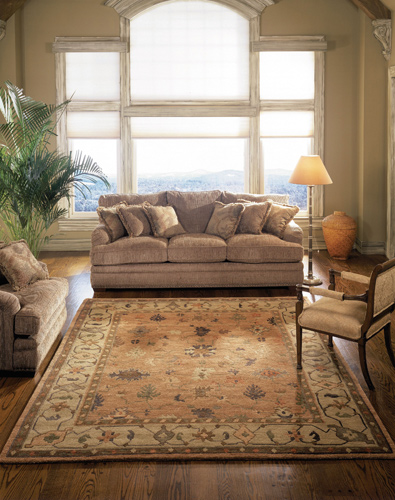 light colored tribal area rug placed in an airy living room