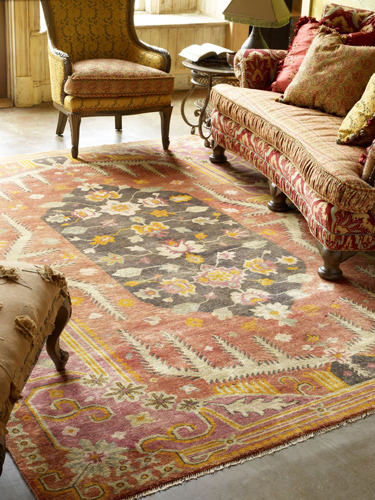 large area rug placed below elaborate furniture pieces