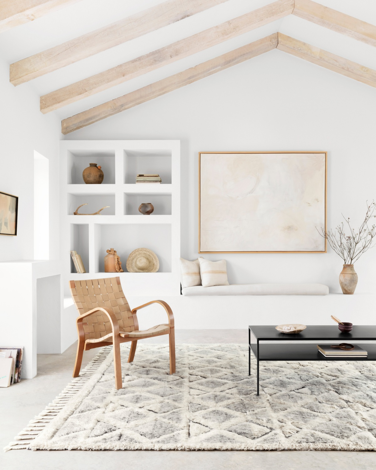 white room vaulted ceiling with brown accents