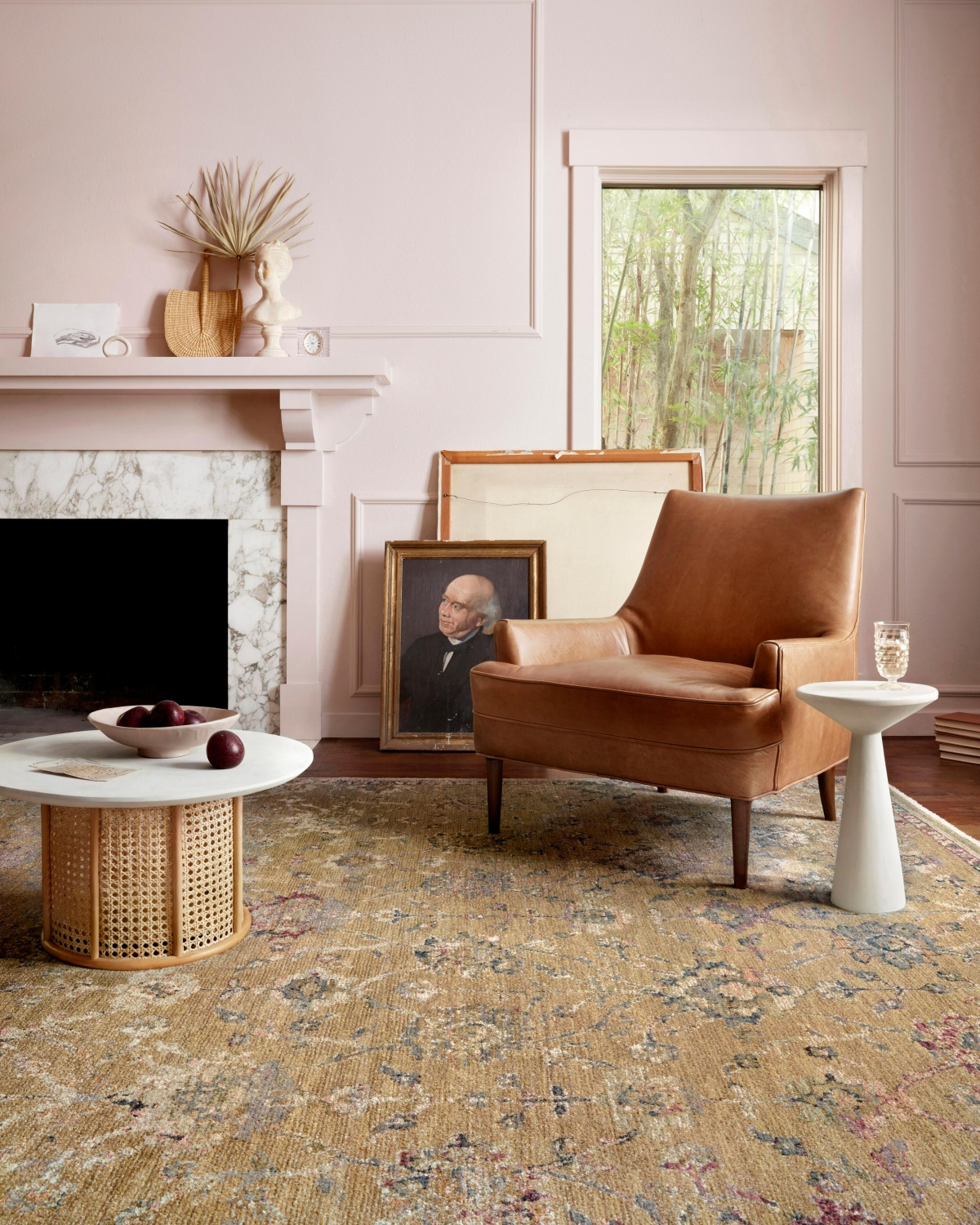 pink living room with a brown rug
