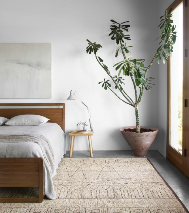 boho-inspired bedroom with a textured brown rug