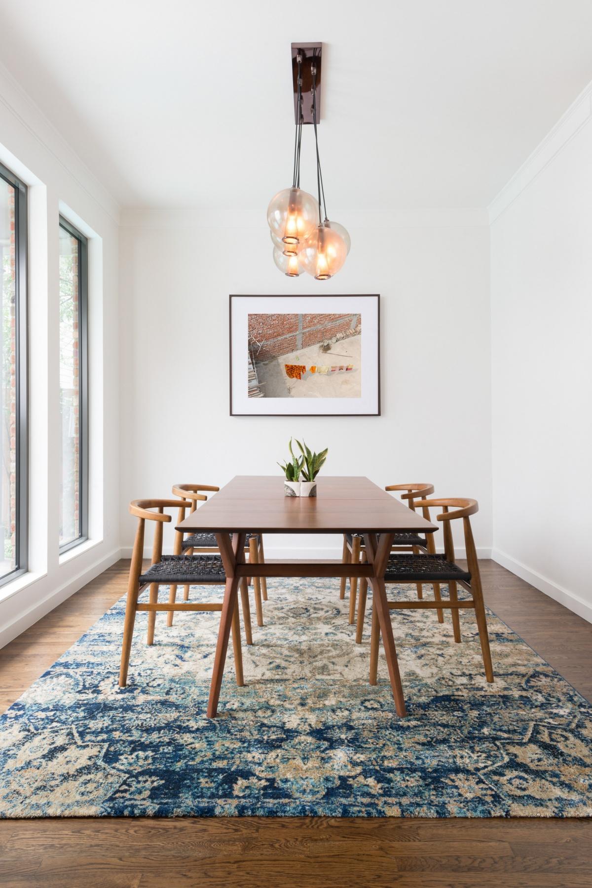 bohemian-scandinavian dining room with statement lights