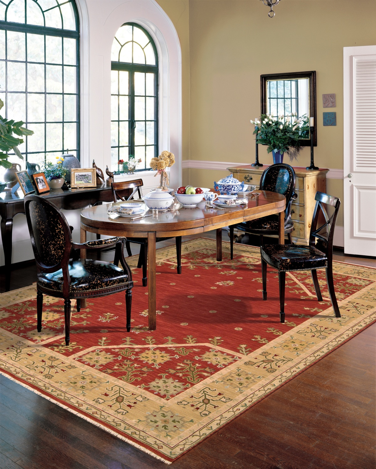 classic dining room with red and gold rug