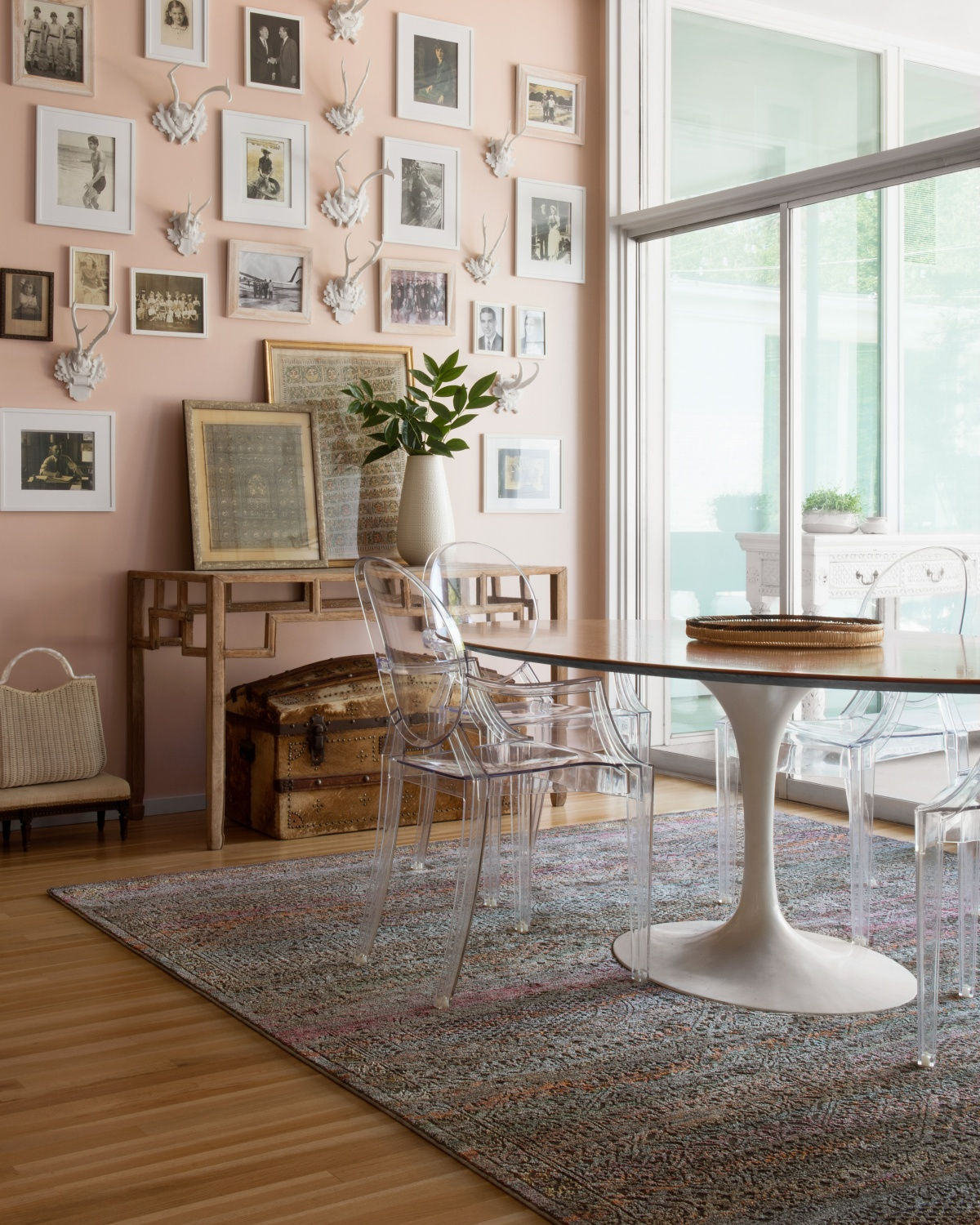 pink dining room with wall art
