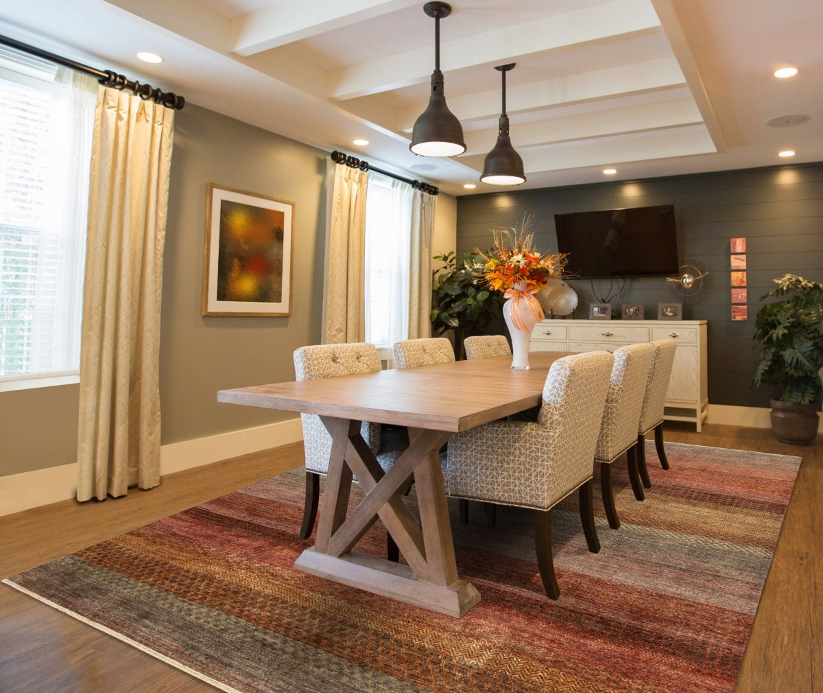 transitional dining room with a rug