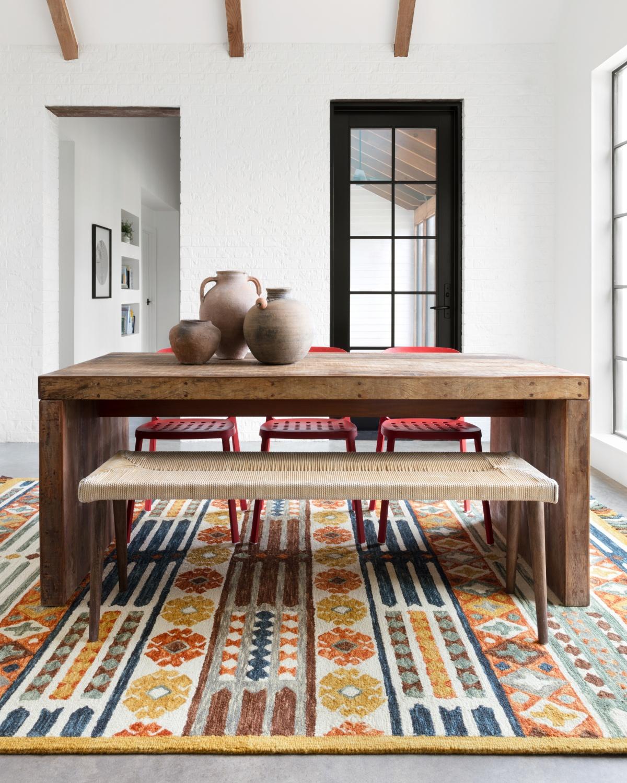 Wabi-sabi dining area with wood, ceramics, and woven art